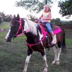 my little cousin riding her (: