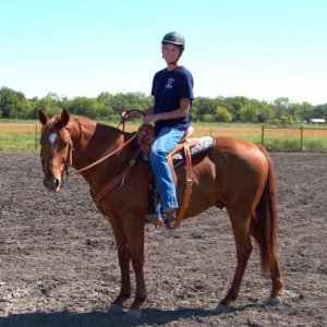 Rascal and I. Hard to believe we couldn't even get a saddle on him 2 years ago.