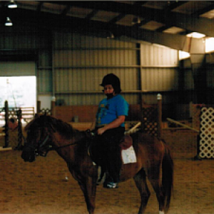 This is a picture of me at age 8 at my first horseback riding lesson. I feel sorry for the poor pony.